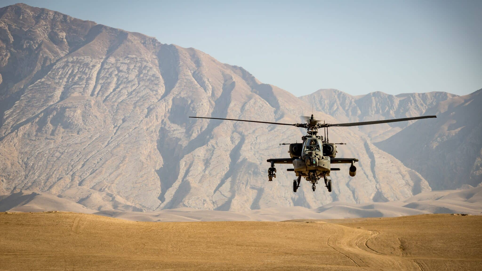Apache attack helicopter in approach